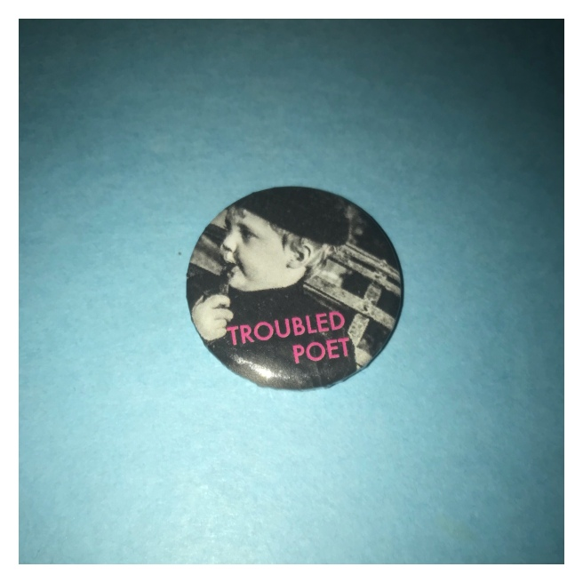 Troubled poet badge