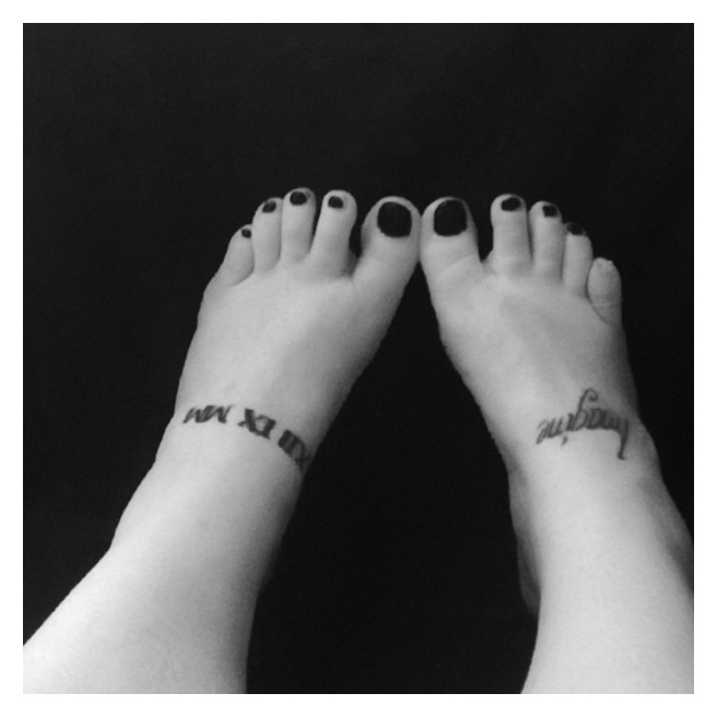 Black toe nails & tattoos