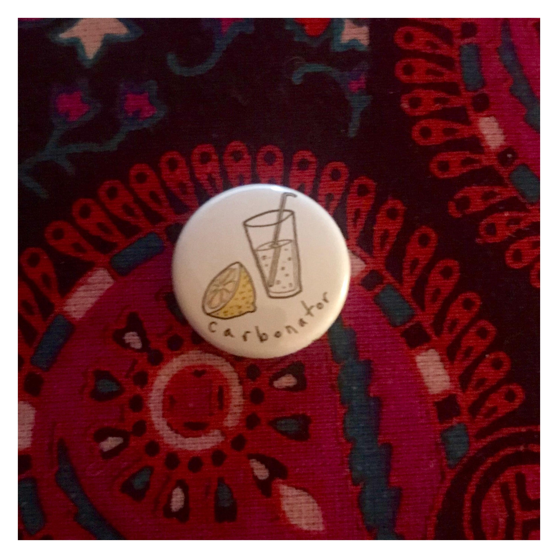 Carbonated badge