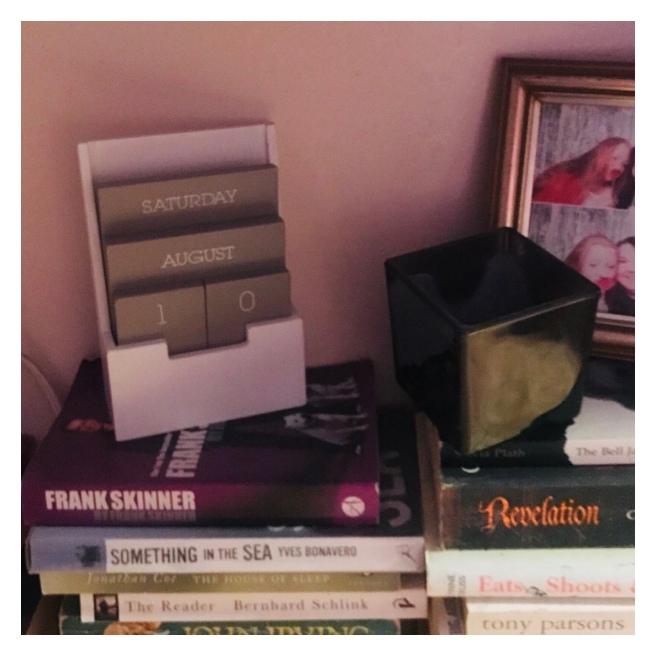 Calendar on pile of books