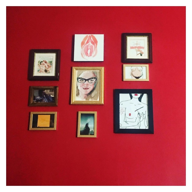 Framed art on red wall