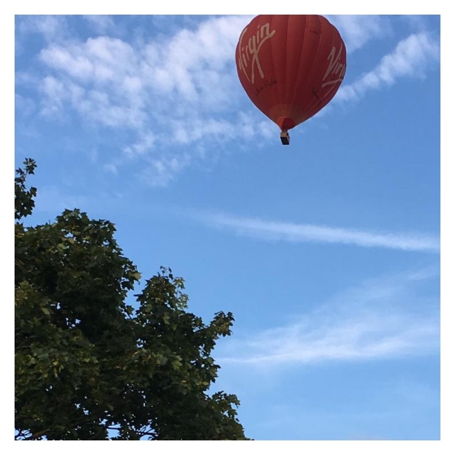 Red hot air balloon in the sky