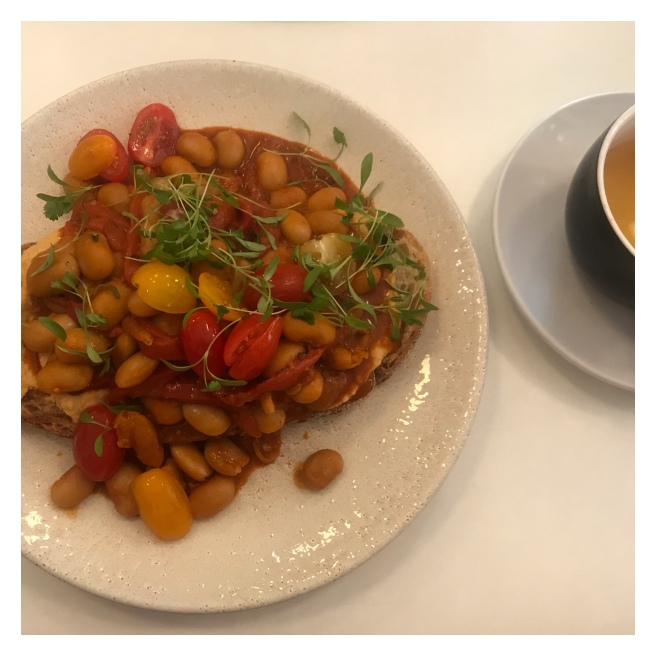 Butter beans in toast and cup of mint tea