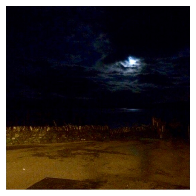 Moon in cloudy sky