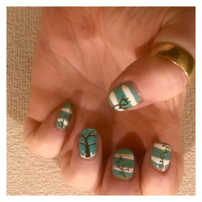 Xmas nail art. String lights on blue & white background