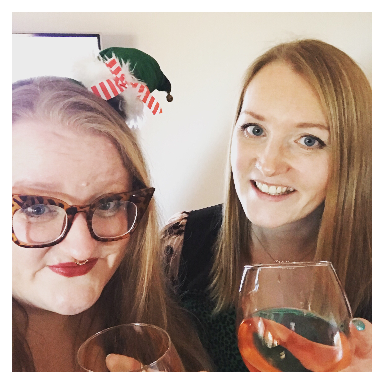 Two women drinking wine