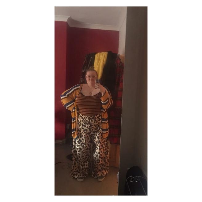 Plus size woman in leopard print trs & stripey vest