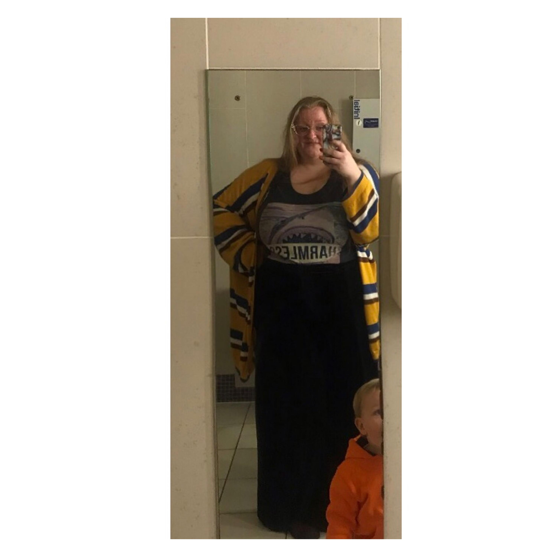 Plus size woman in shark vest & velvet trs
