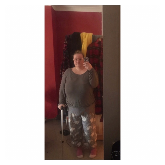 Plus size woman in jammies with walking stick