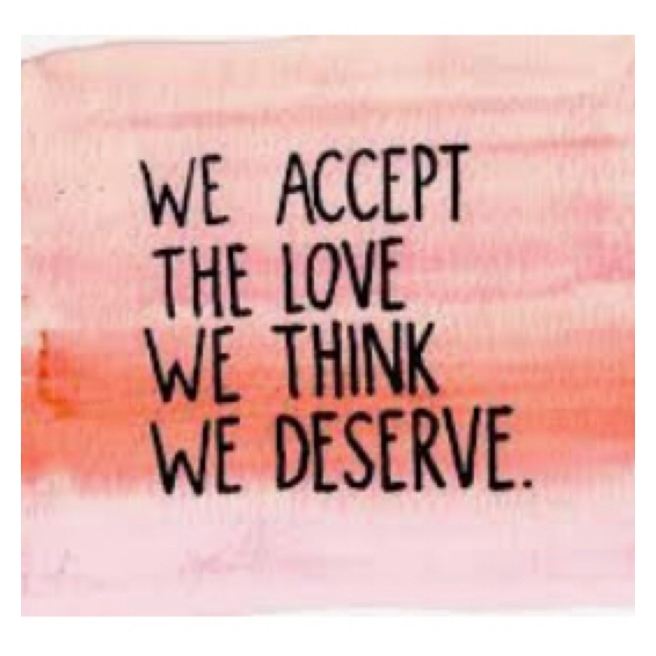 We accept the love we think we deserve in black lettering on pink background