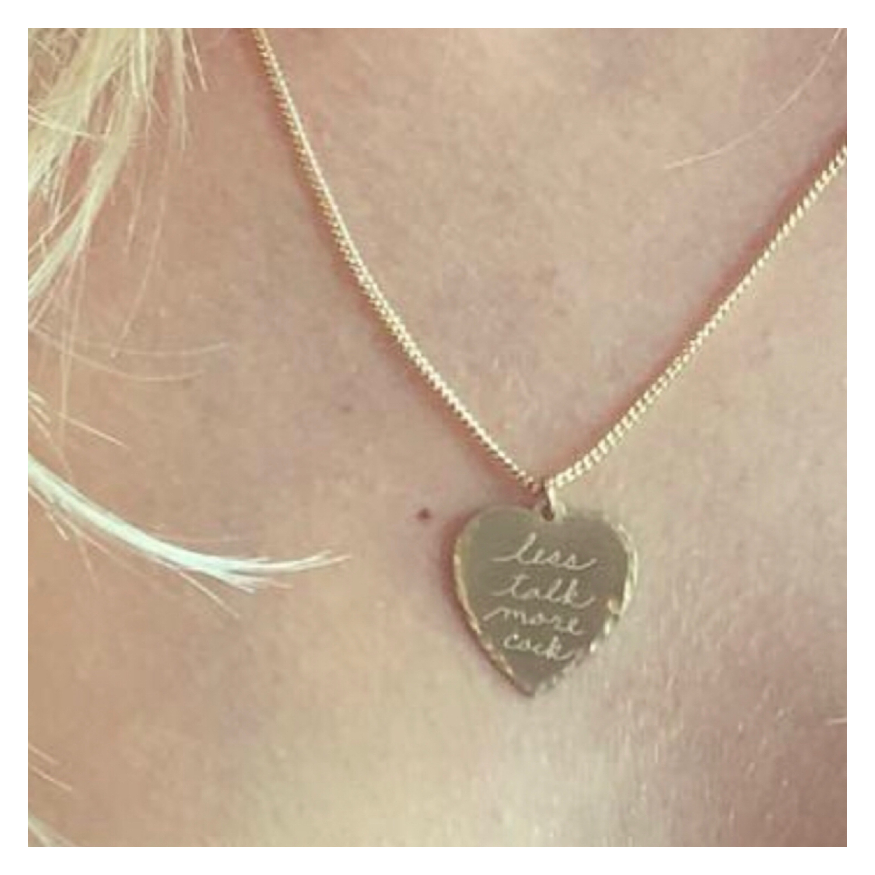 Good love heart pendant with the inscription, less talk more cock