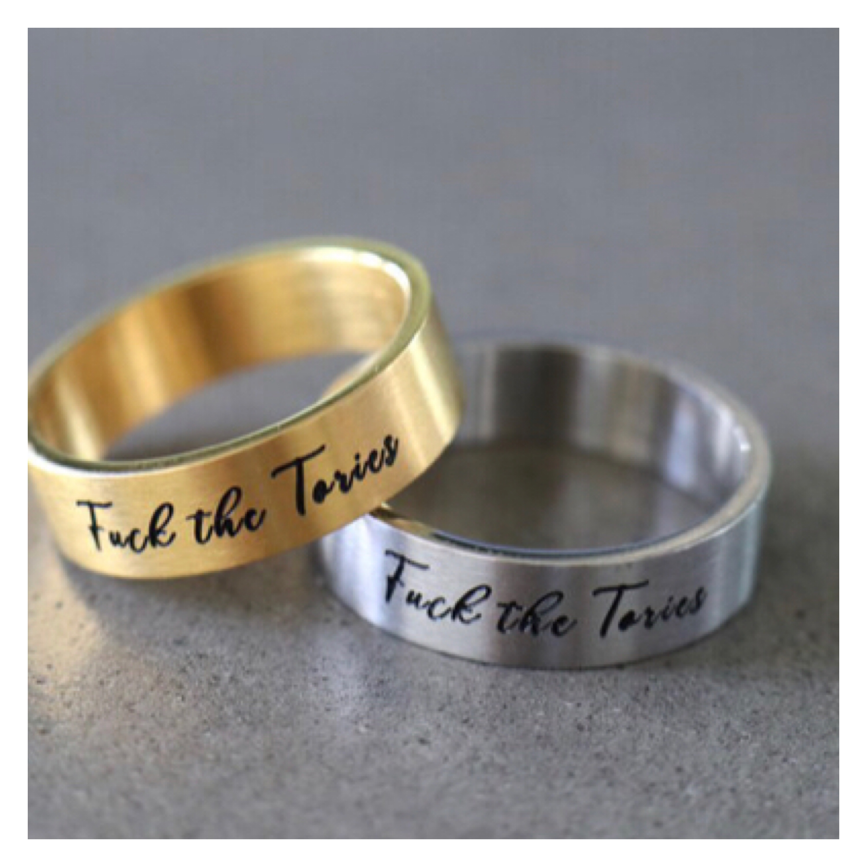Gold & silver band rings engraved with fuck the Tories