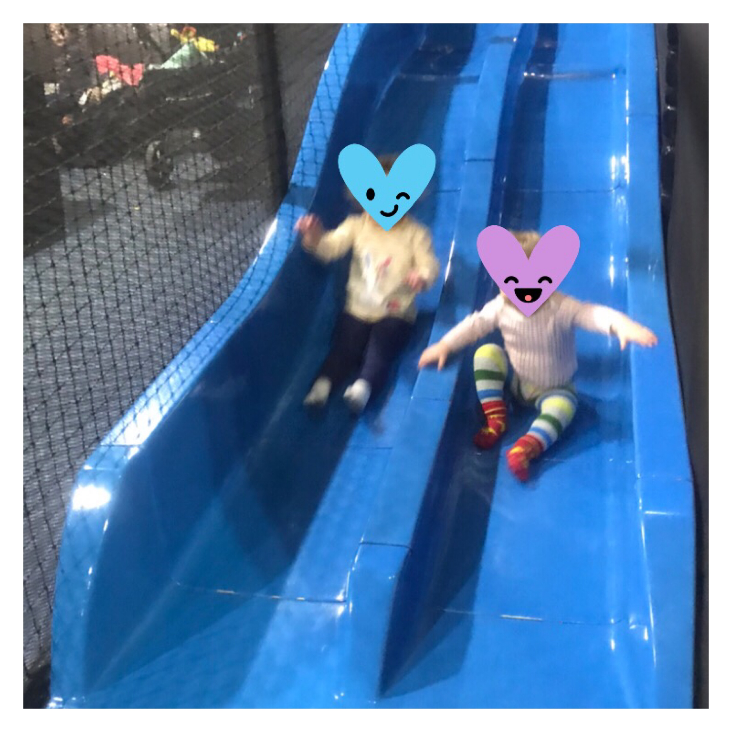 Toddlers on big blue slide