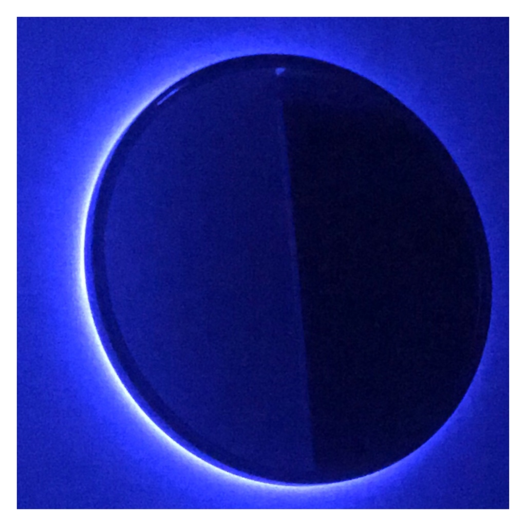 Circular mirror with blue backlighting