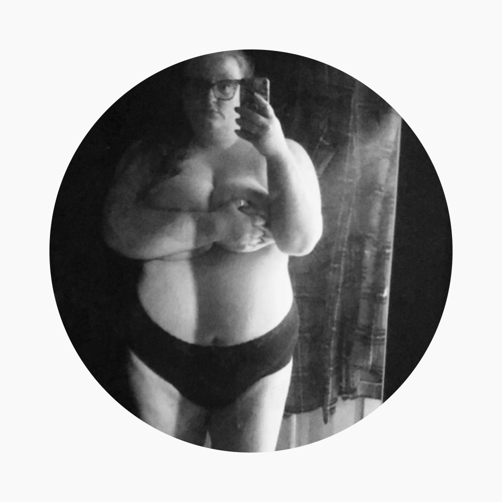 Black & white photo of plus sized women in knickers holding her breasts