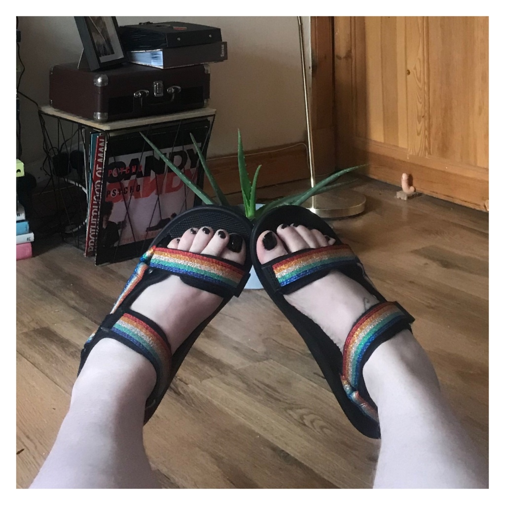 Rainbow sandals on pale feet