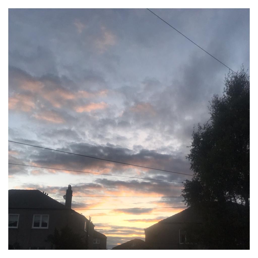 Sun shining beneath  dark clouds