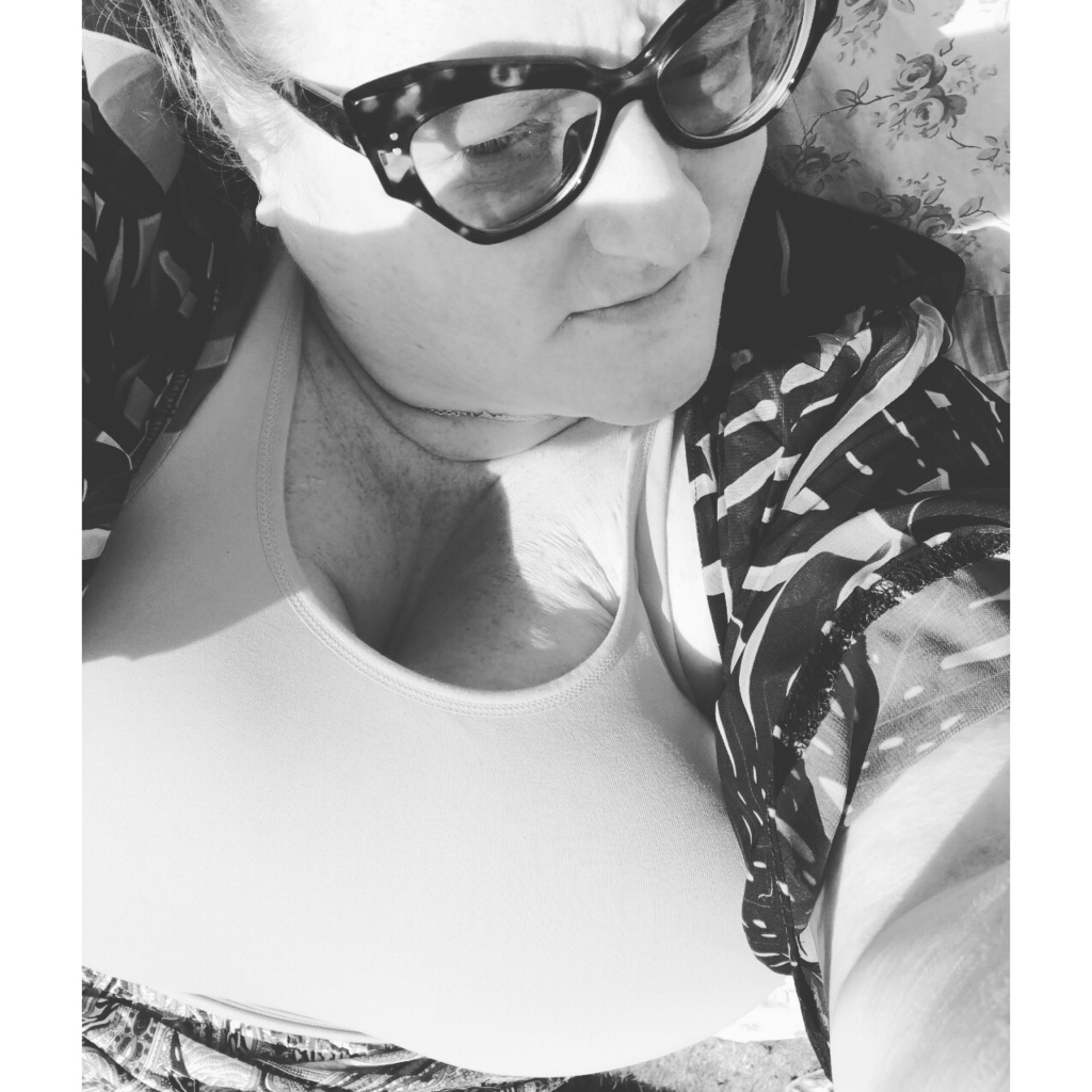 Black and white image of plus size women in sunglasses