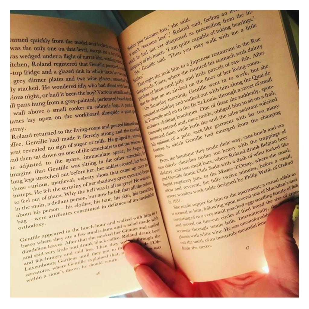 Thumb & forefinger  holding book open