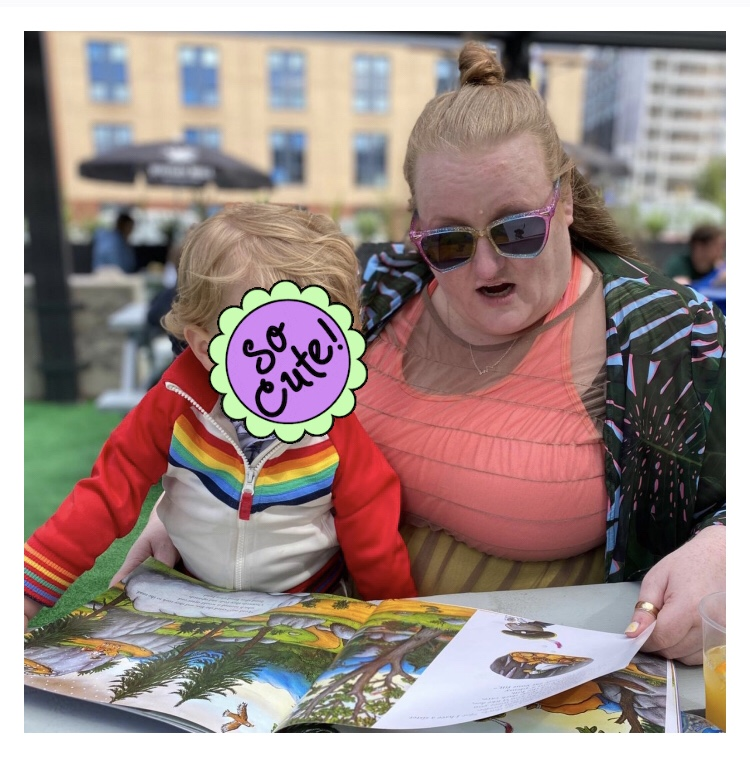 Plus size woman reading toddler a story