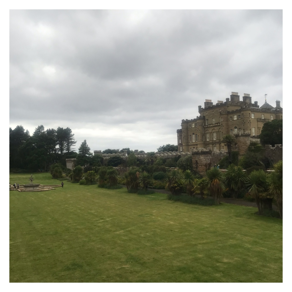 Culzean castle, formal garden with  large decorative water fountain on lawn