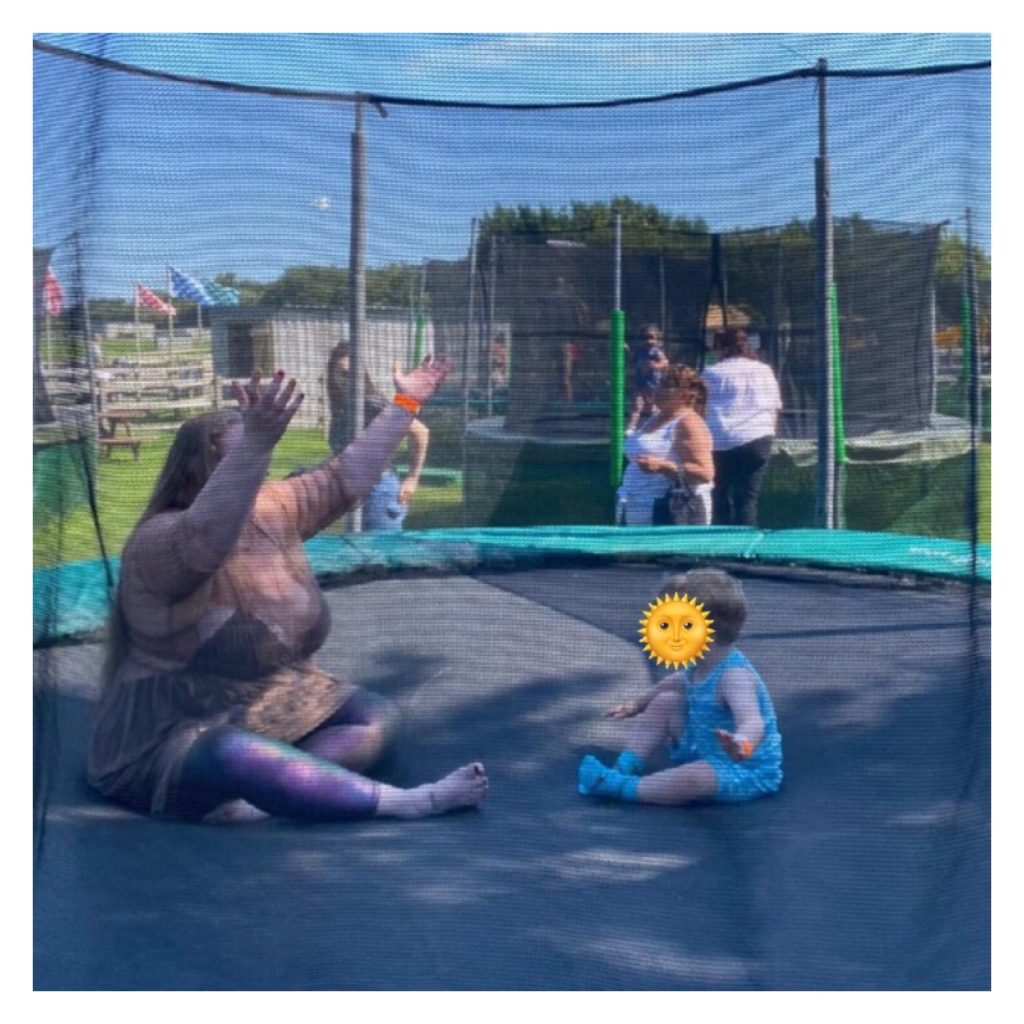 Plus size woman and toddler on a trampoline