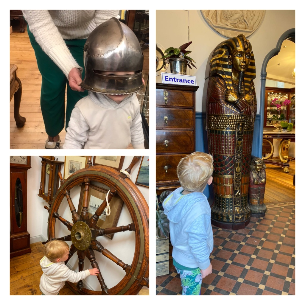 Toddler in armoured helmet and looking at  Egyptian sarcophagus