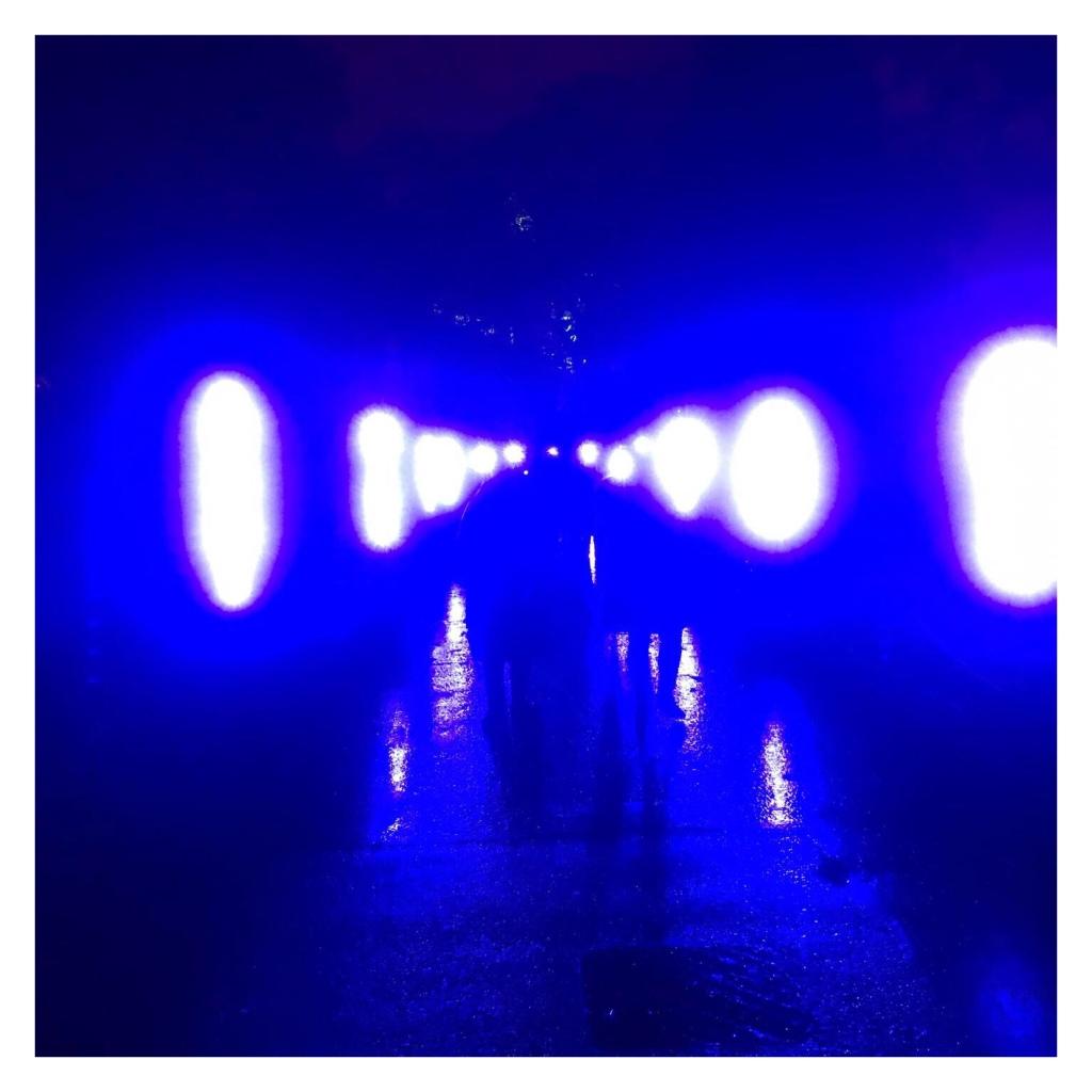 Blue neon lights blurring in rain