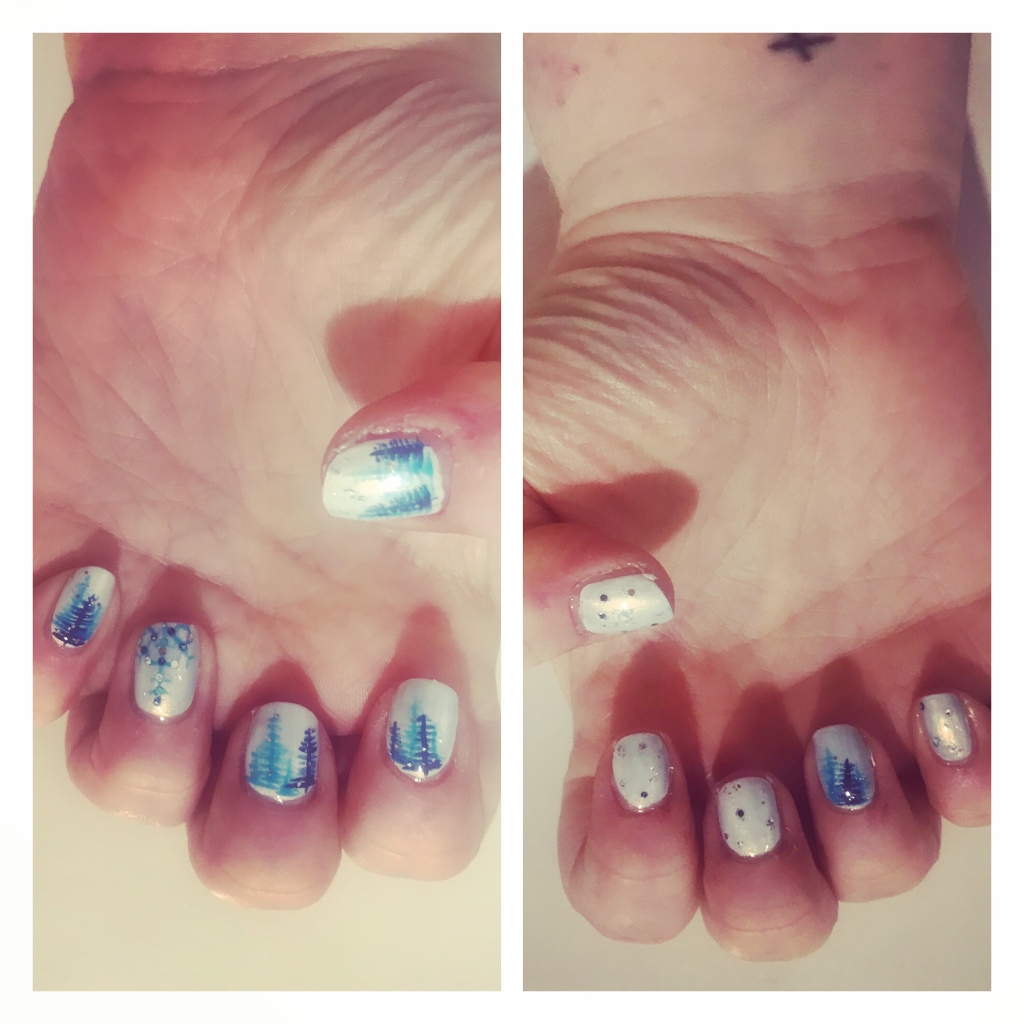 Shimmery white nails with blue Xmas trees and sparky snow flake