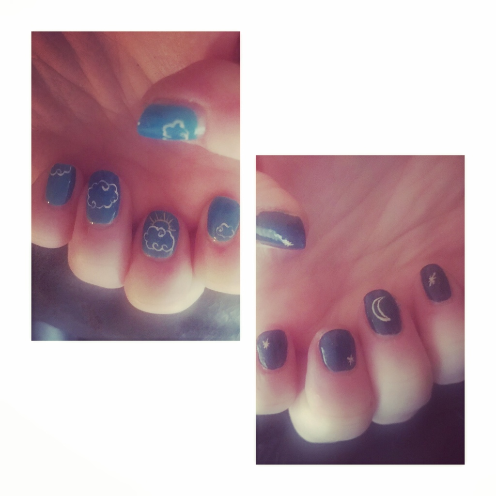 Blue manicure with clouds &  sun on one hand moon &  stars on other