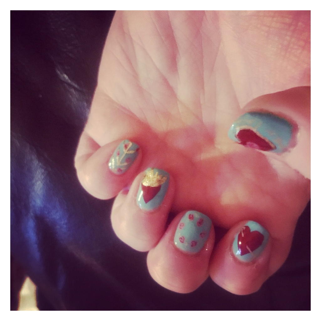 90's Romeo & Juliet style manicure with flaming hearts, gold barbed wire & tattoo style roses