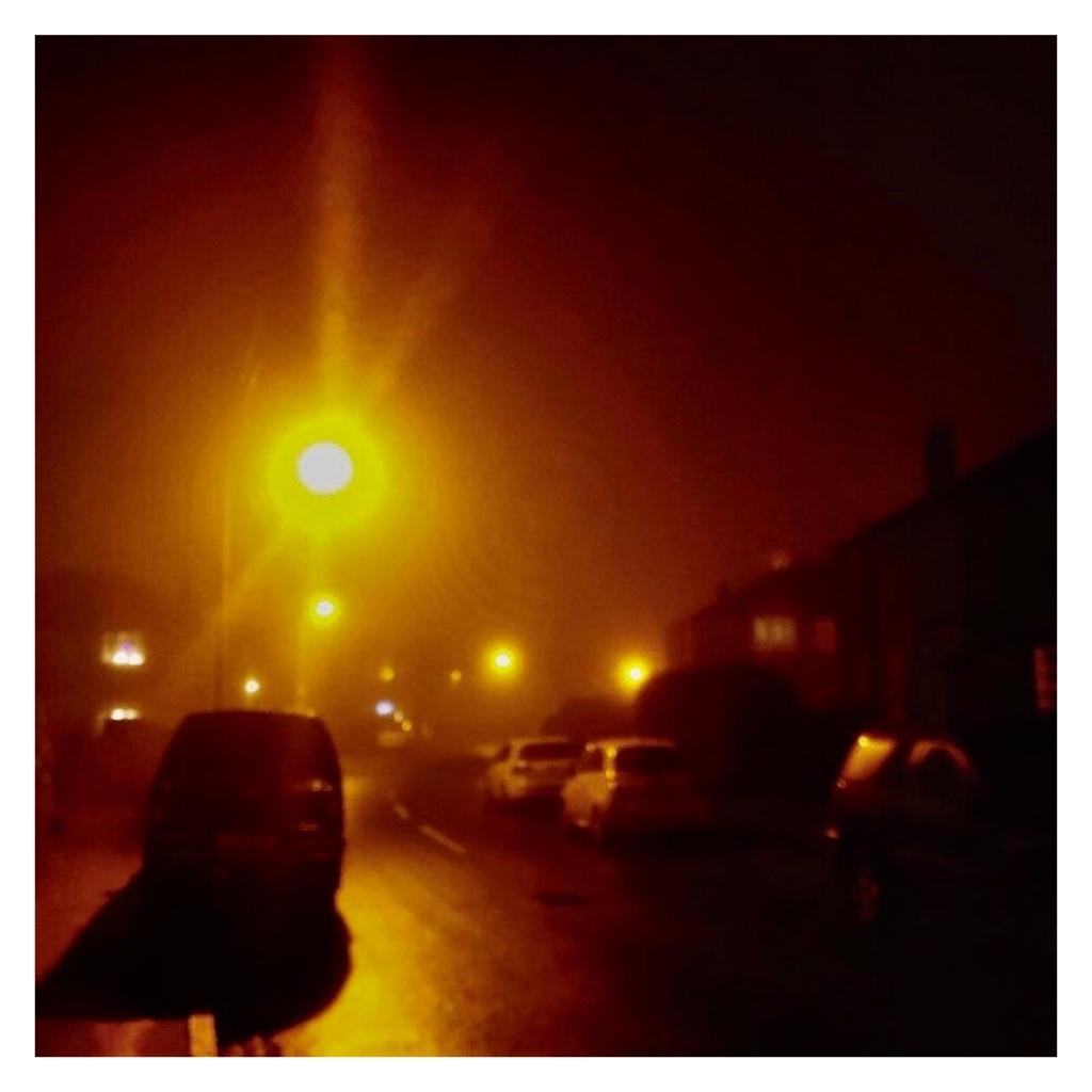 Dark,  foggy residential street