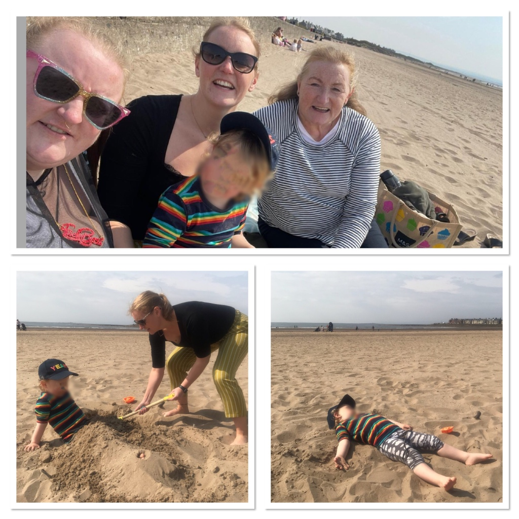 Toddler burying feet and lying in sand