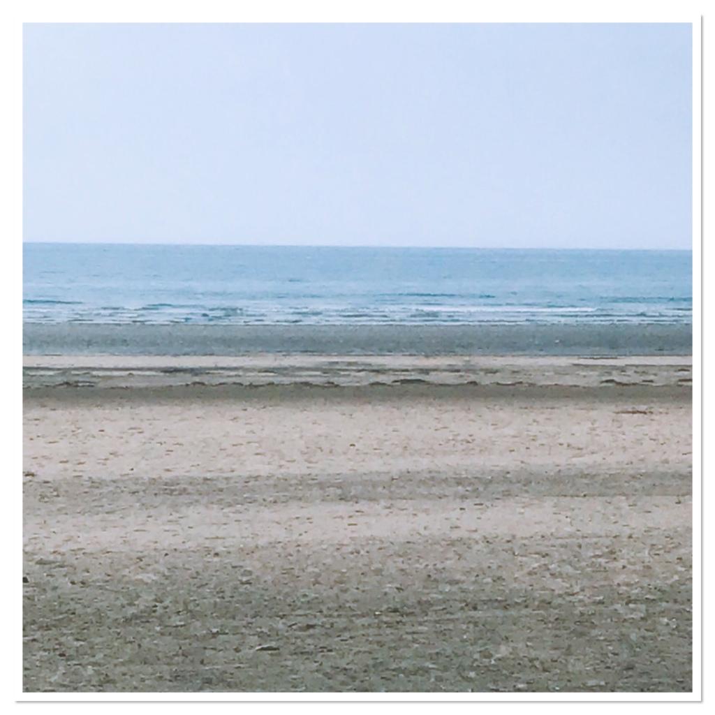 Calm blue sea & sandy beach