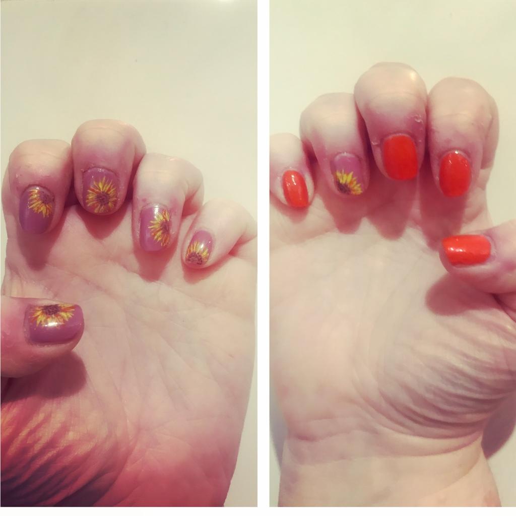Orange manicure with sunflower design