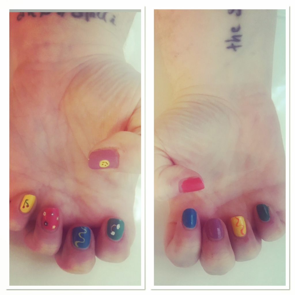 Bright manicure with smiley face, rainbow &  cherries