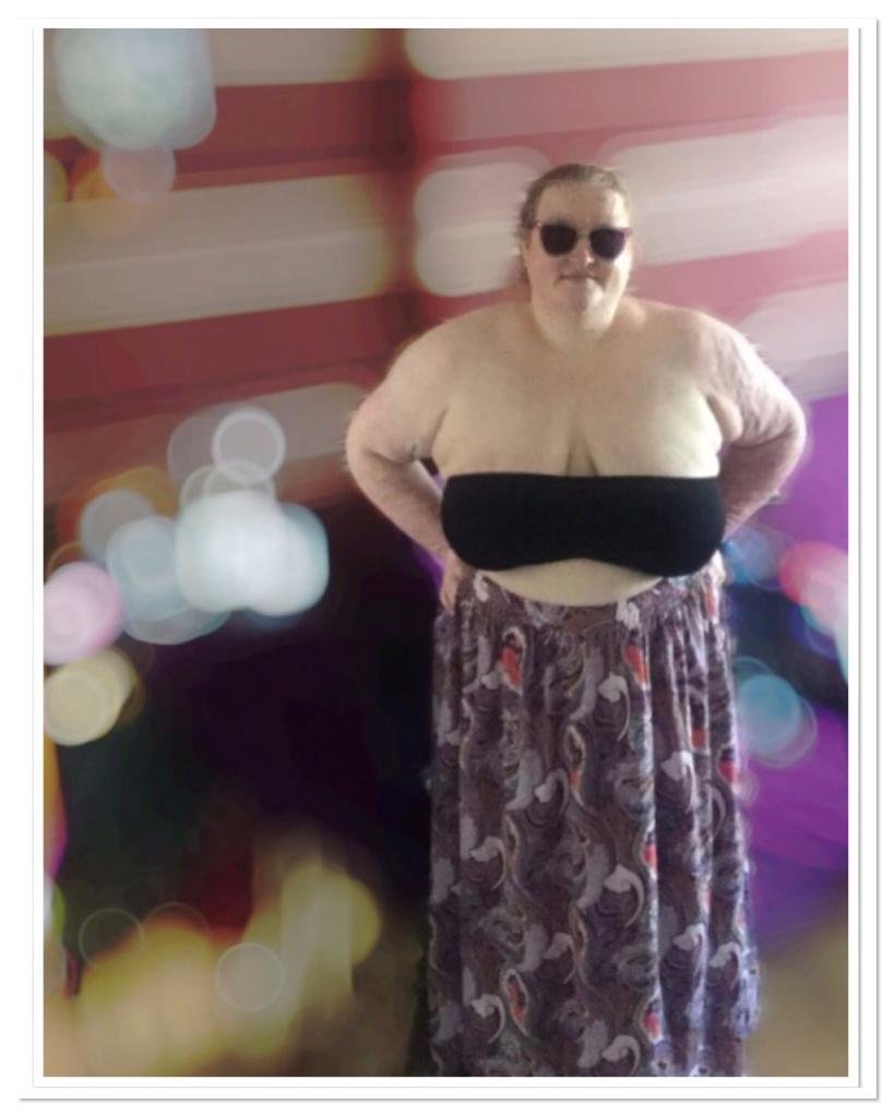 ly is wearing  black bra top, paisley print maxi skirt & sunglasses