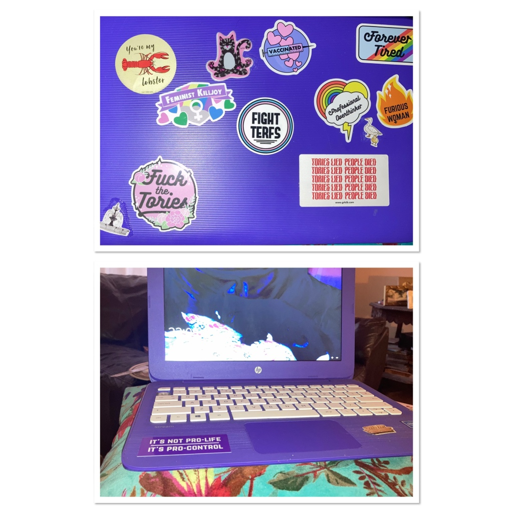Purple laptop with bright coloured stickers