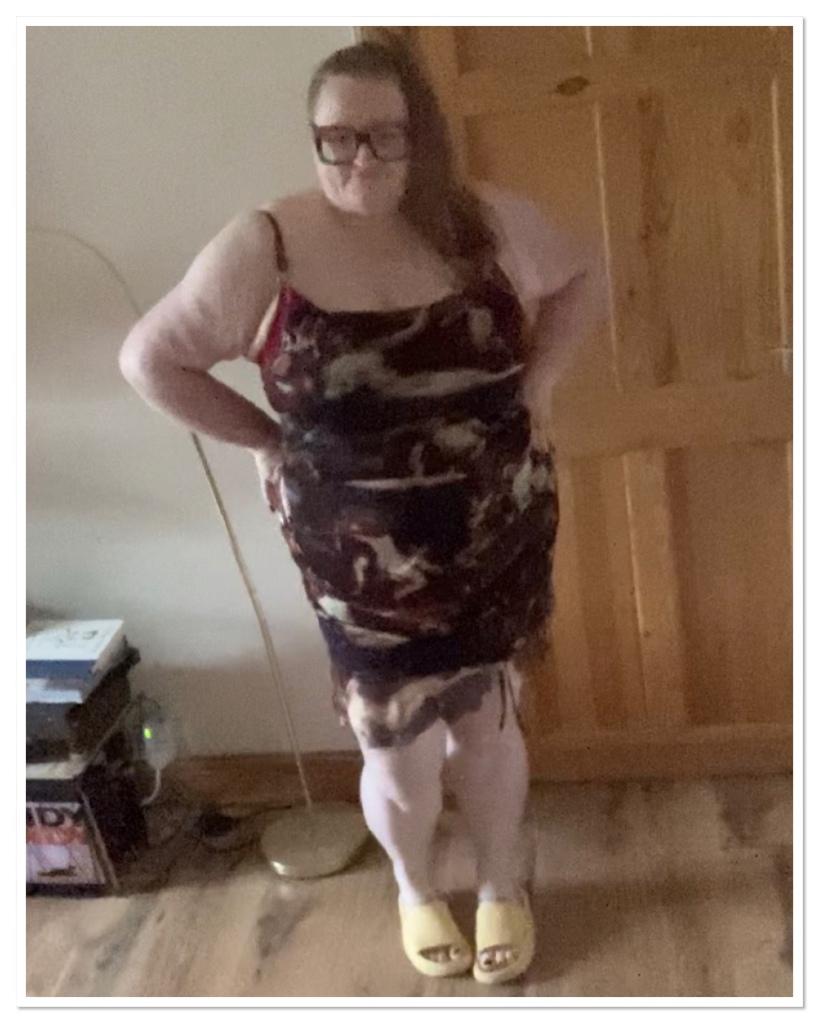 Ly is wearing a form fitting churub print dress