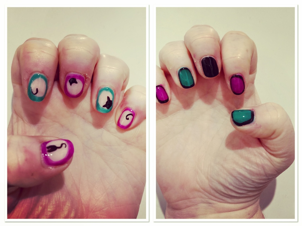 Blsck cat faces &  tails popping out of purple & green frames  manicure