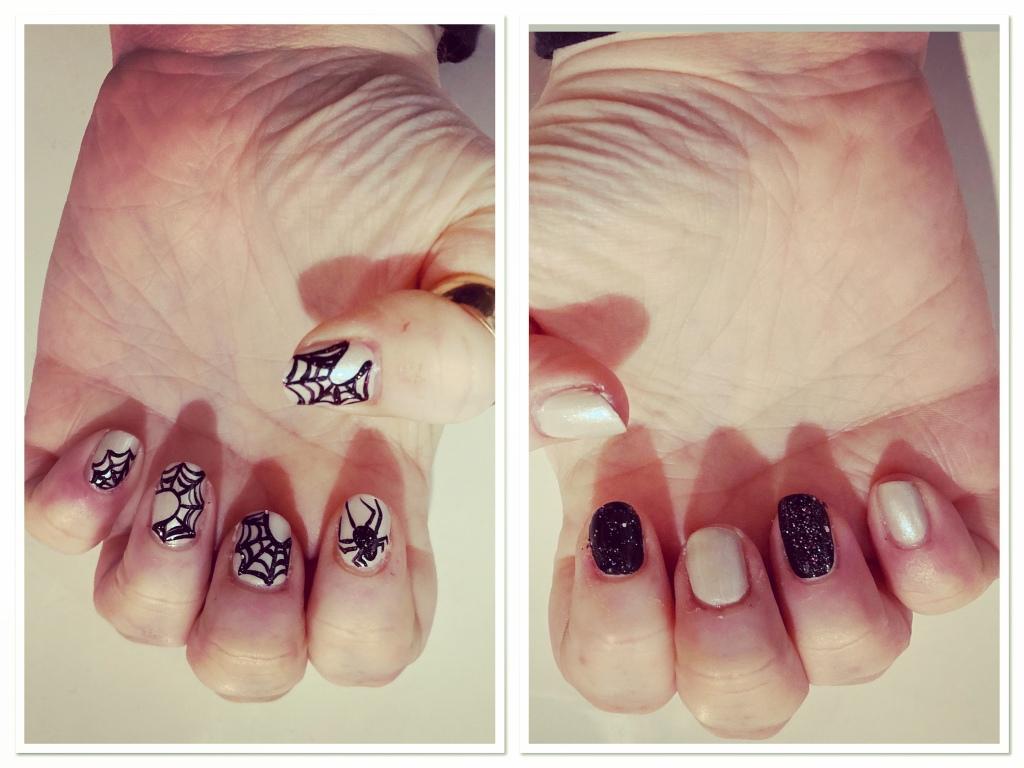 Spider web manicure. Sparkly black webs on white background